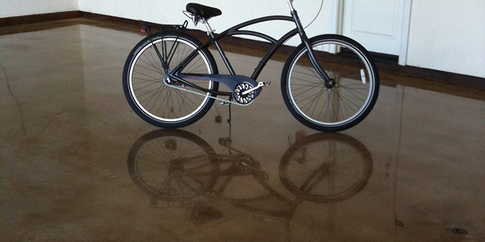 Bicycle's Reflection on Polished Concrete Floor