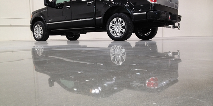 Black Pickup Truck's Reflection on Polished Concrete Floor